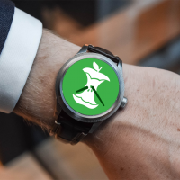 Watch on a person's wrist. The face of the watch is a symbol for food scraps.