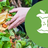 Hand placing food scraps in bin next to food scrap symbol.