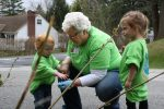 A woman and two children helping to pick up trash along a Vermont roadside.