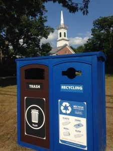 A trash and recycling station sit on the Jericho Green.