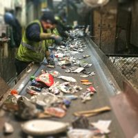 Workers sorting materials at the recycling facility.