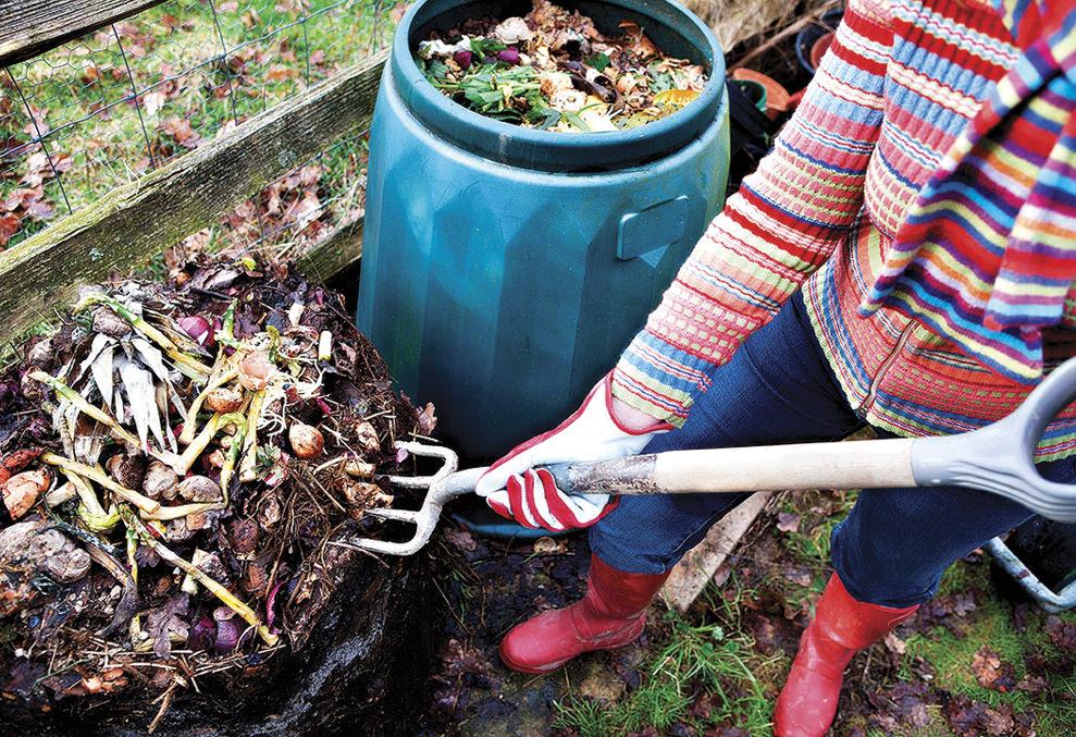 Turning backyard compost pile