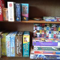 A bookshelf showing a variety of board games