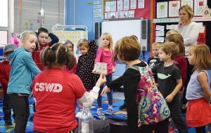 Our school outreach coordinator, Rhonda, with a group of kindergarten students at Hiawatha Elementary School