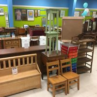store filled with chairs, dressers, benches and tables