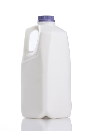 A half-gallon mild jug with a purple lid.