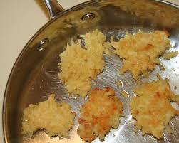 Latkes in a frying pan.