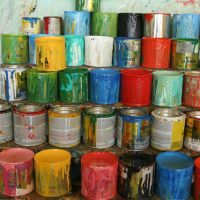 5 stacks of messy paint cans