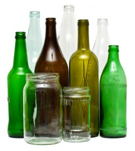 A variety of glass bottles in multiple colors such as clear, green, and brown glass.