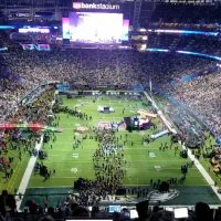 Football stadium at the Super Bowl with a packed crowd.